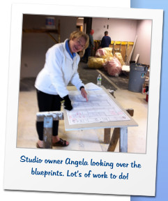 Studio owner Angela looking over the blueprints. Lot's of work to do!